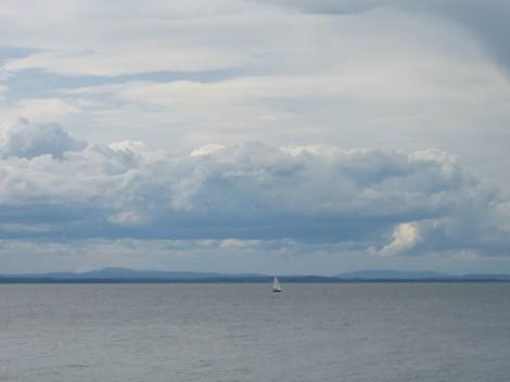 Storsjön med fjällen i bakgrunden, en vacker åskvädersdag i Juli