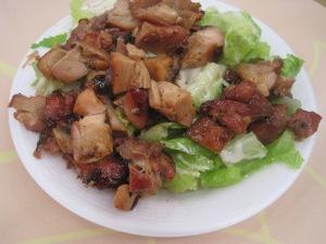 Ceasar Salad med Bourbon Chicken på Kelly's Cajun Grill...